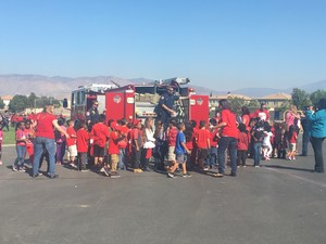 Students walking around the Hemet Fire Department fire truck.