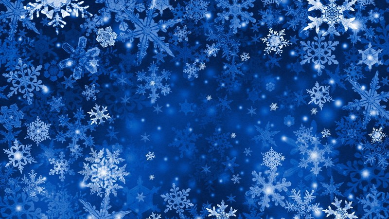 White snowflakes of varying sizes scattered across a deep blue background.