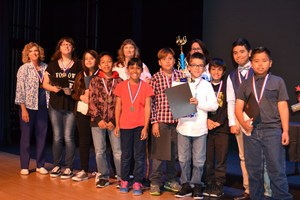 Members of the Elwin Elementary School Electro Pups stand with their medals and trophies after winning Baldwin Park Unified's first-ever 21st Century Challenge, an engineering and design contest that replaced the District's Spelling Bee.