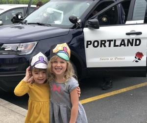 Police Officers visiting with preschoolers