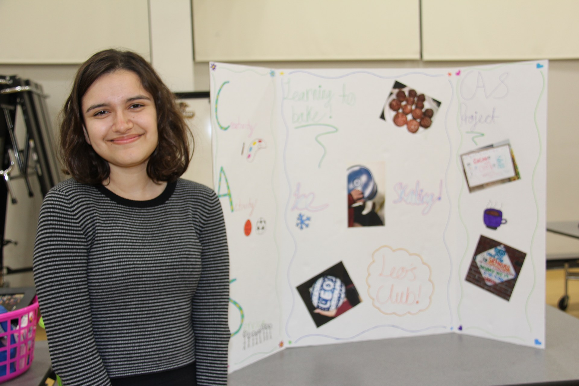 Image of IB Diploma Candidate with her presentation board at CAS Celebration Event