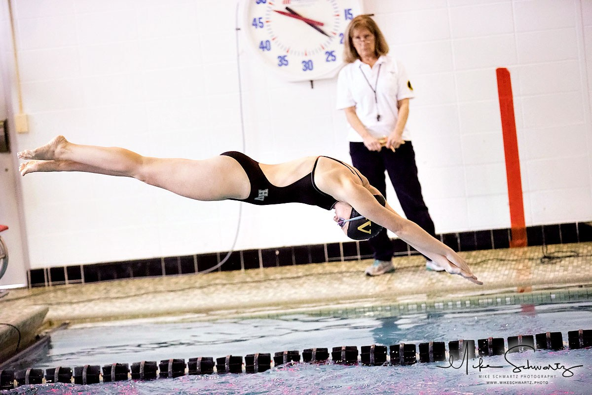 CHS girls swimmer dives into the pool from starting block