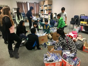 CCA students and families take time out of their busy schedules to help the homeless.