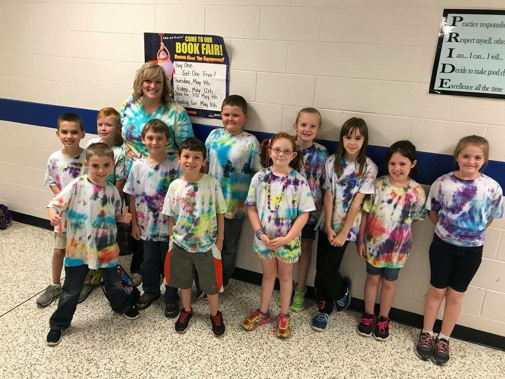 Mrs. Vance with her students in the hallway