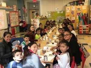Kindergarten class have tea with their moms