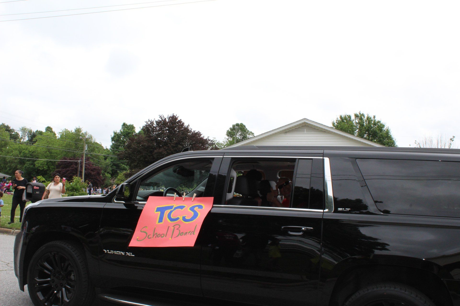 TCS school board members in black SUV