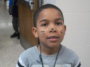 Students dressed as a cat for Dr. Seuss' birthday.