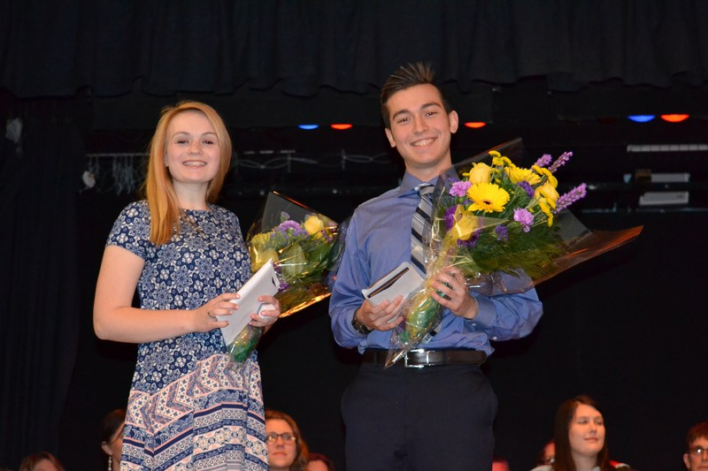 Rachel Kuchnicki and Daniel Shaw pose with bouquets of flowers after being named salutatorian and valedictorian