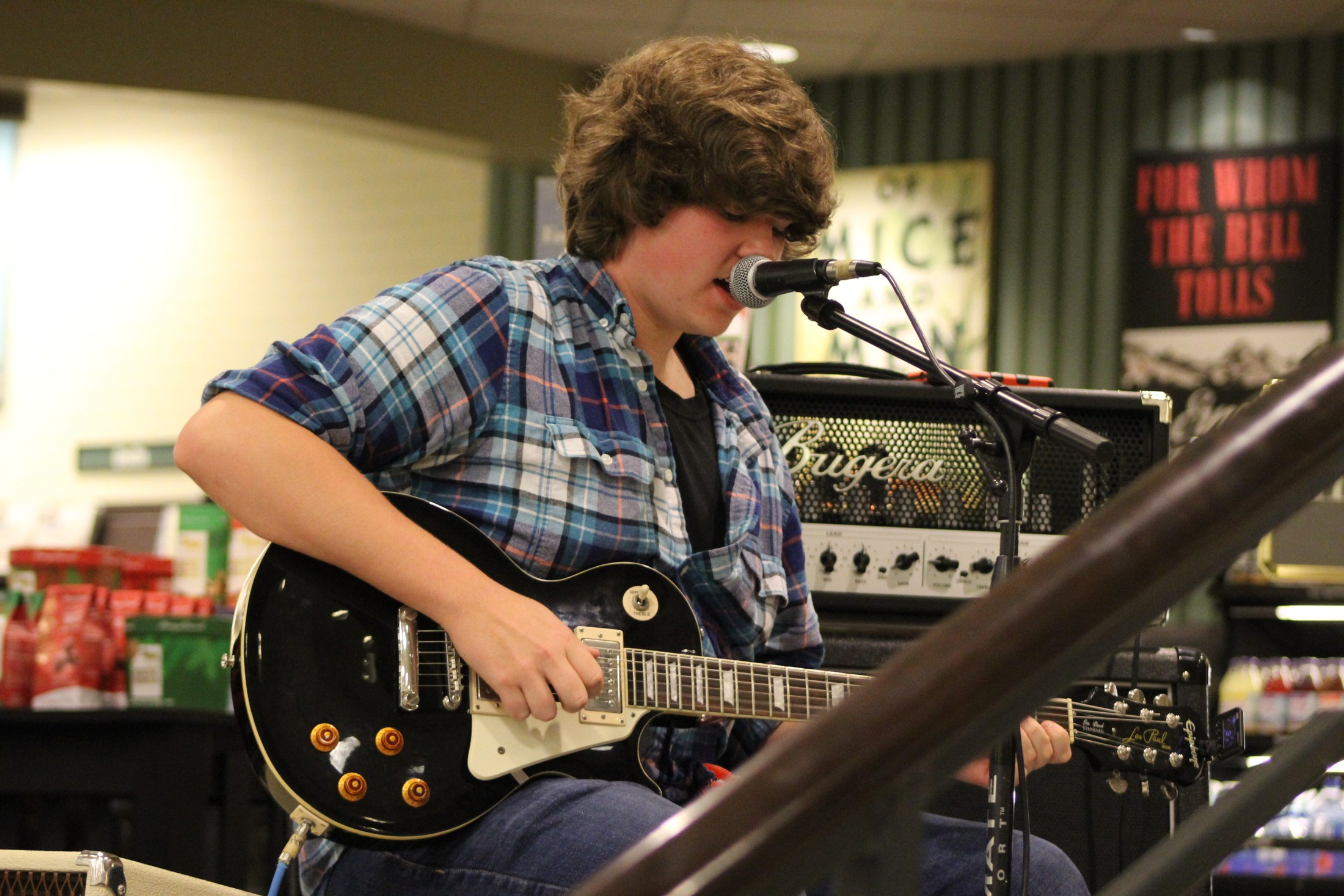 Zach masters plays his guitar at the rock ensemble showcase during barnes and noble night.