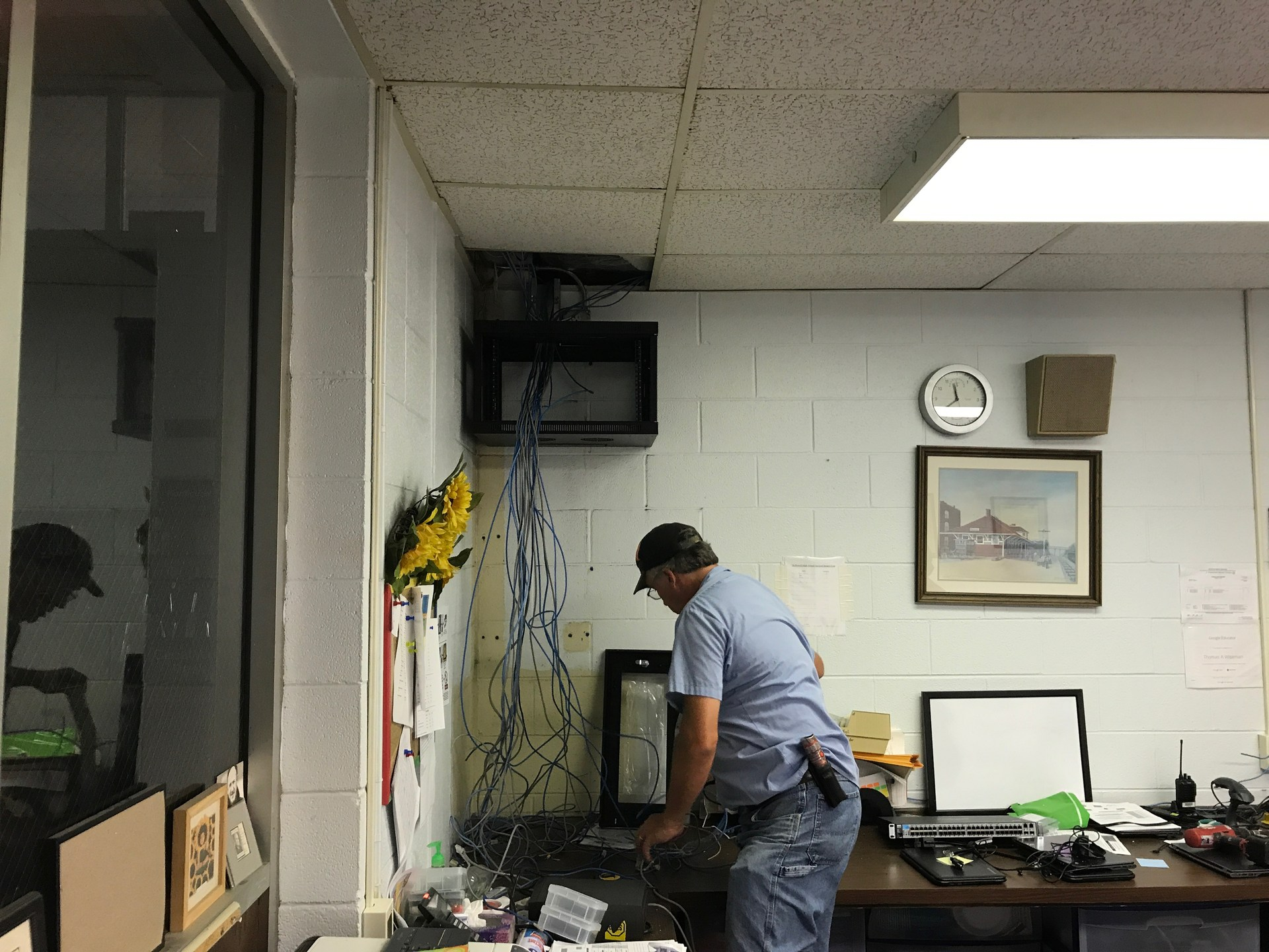 Maintenance department assisting with wiring