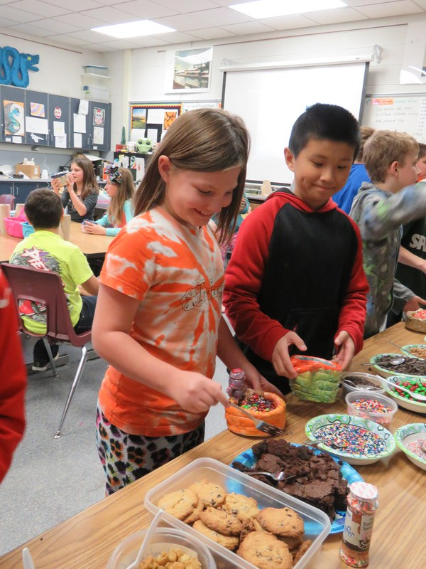 Page fifth grade students enjoy an ice cream sundae served up in their own handmade bowls.