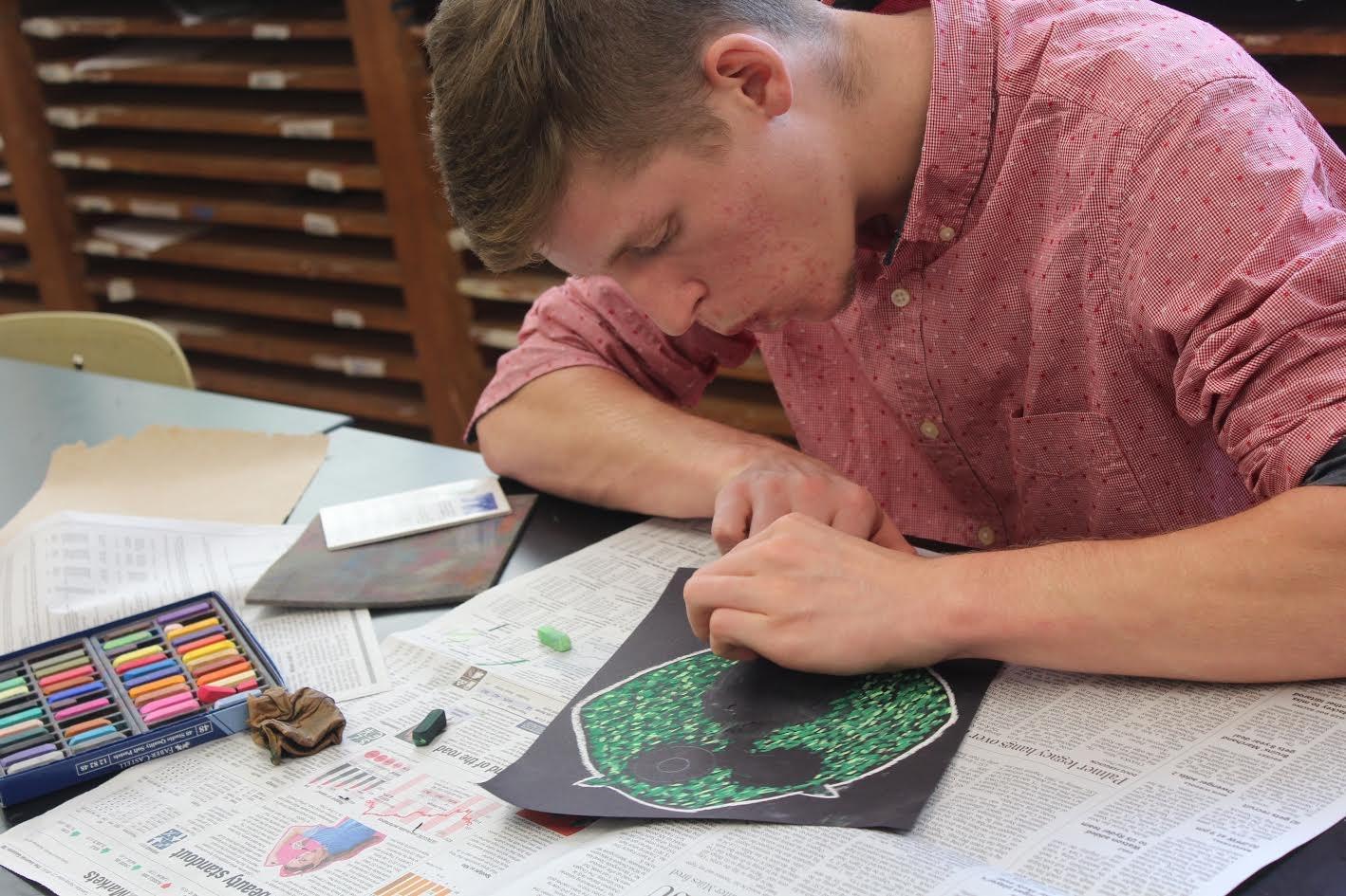 Kaleb Kelsheimer using chalk pastels