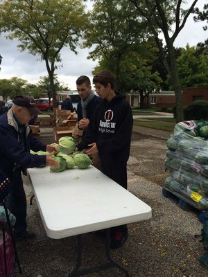 Invictus Students hand out food in parma heights