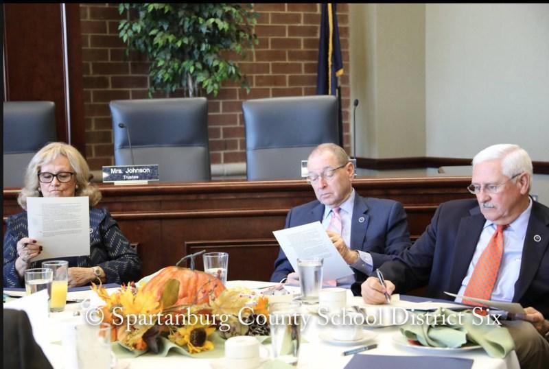 A picture of three legislators visiting District Six.