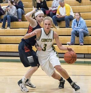 Coloma's Hannah Mathis (3) drives to the basket.