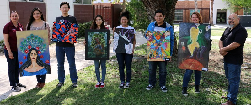 several of the students holding their artwork pieces