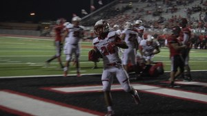 Ezekiel Charles runs in for the game winning touchdown against Del Valle.