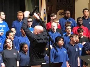 Mr. Naum conducting the chorus