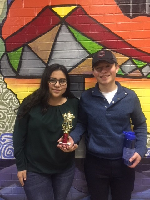 Two members of the Soto Debate team hold their trophy