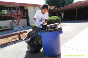 Del Mar High student Sonali Ranaweera recycling