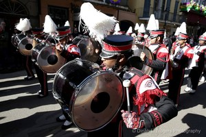 A photo of the Baker High School Band leading the Krewe of Cork parade on Royal Street in New Orleans