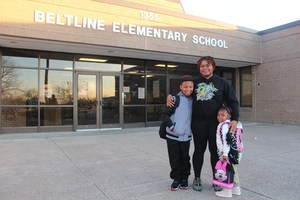 Pre-K Family in front of school