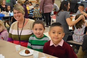 Kindergarteners enjoying the Muffins with Moms events with Vice Principal, Ms. Robillard.