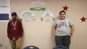 Cameron Canada and Habib Jaffers with their medals for winning the school's competition.