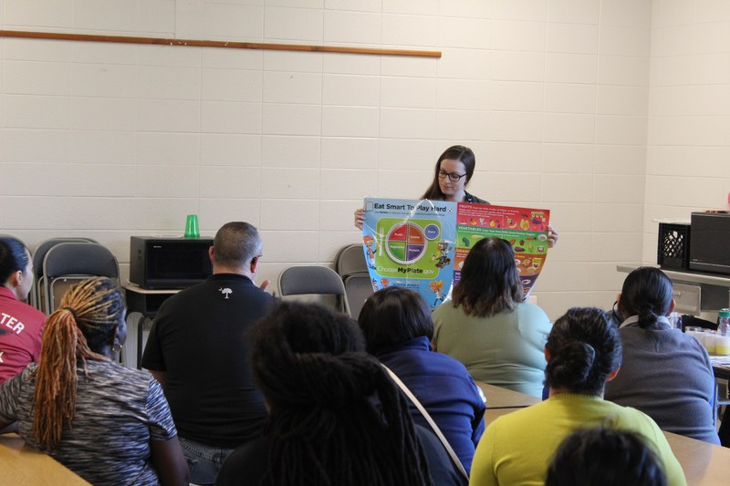 Families learning about healthy food choices.