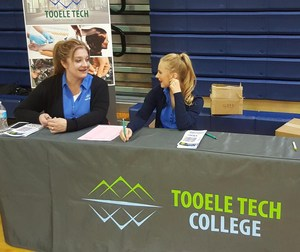 Tooele Tech College Representatives helping at Reality Town