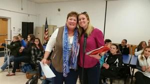 Joan Capella recognized by Principal Jamie VanArtsdalen 2.jpg