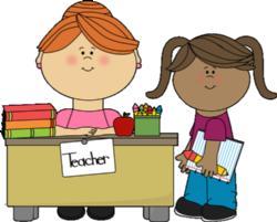student-at-teachers-desk.jpg