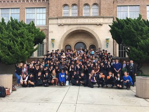 Students from Japan pose with ESHS student in front of the high school.