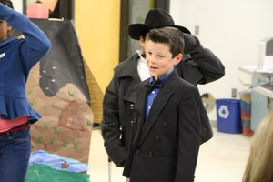 Students present on Colorado history at night at the museum.