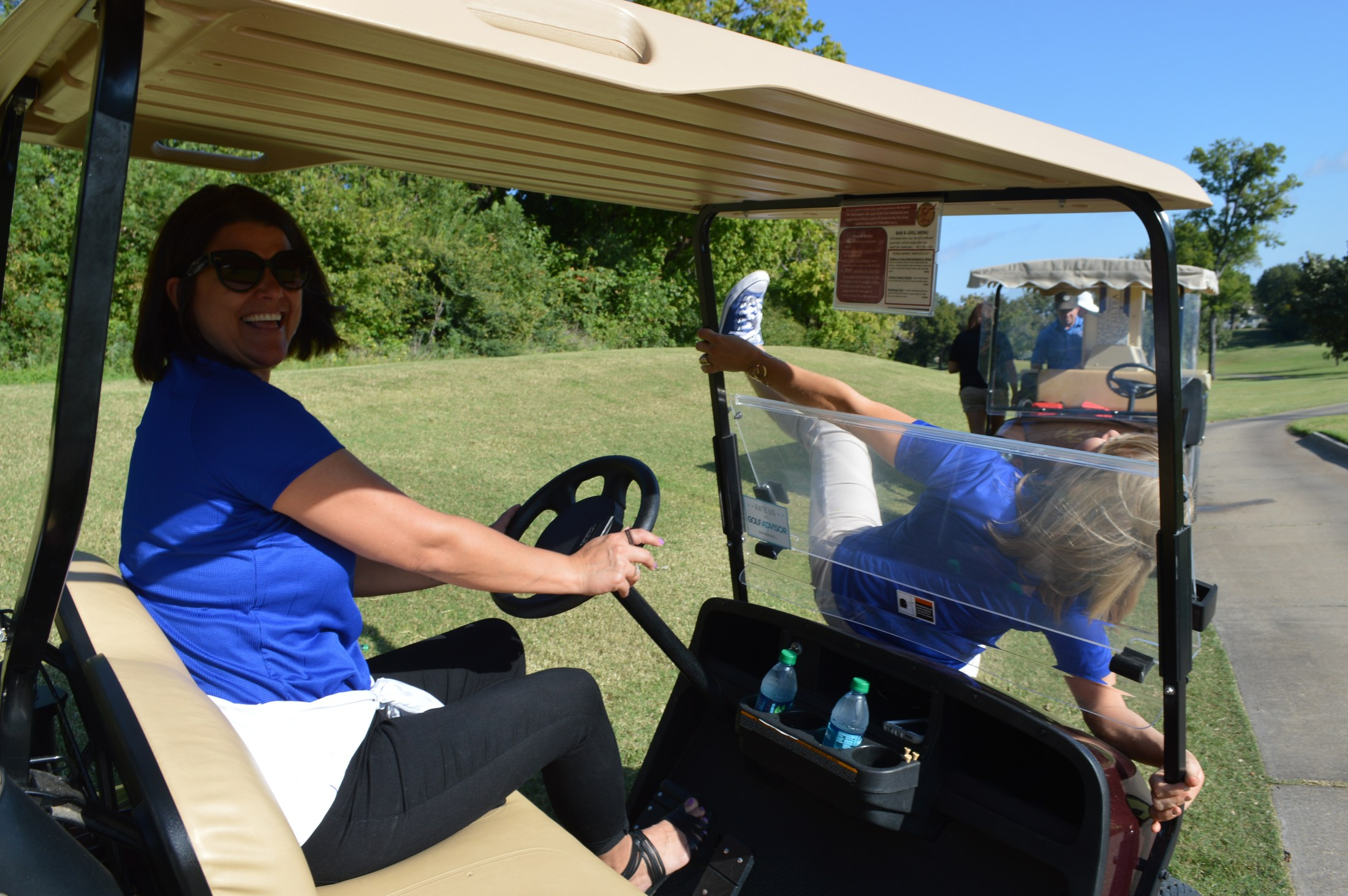 Golf Tournament: Driving in carts