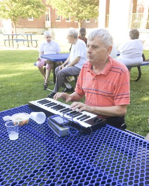 Duane Steele performing on his keyboard and iPhone