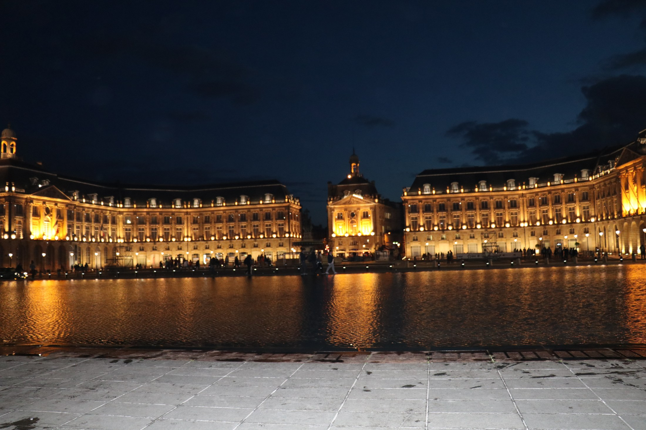 Miroir d'eau (Water Mirror) or Miroir des Quais (Quay Mirror) in Bordeaux is the world's largest reflecting pool, covering 3,450 square metres (37,100 sq ft). Located on the quay of the Garonne in front of the Place de la Bourse, it was built in 2006.  It is made of granite slabs covered by 2 cm of water. In summer, a system allows it to create fog every 15 minutes.