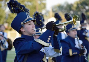 Marching band member playing the trumpet.