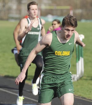 Coloma's Derek Plitt wins the first heat in the 100 meter dash during Wednesday's double dual meet.