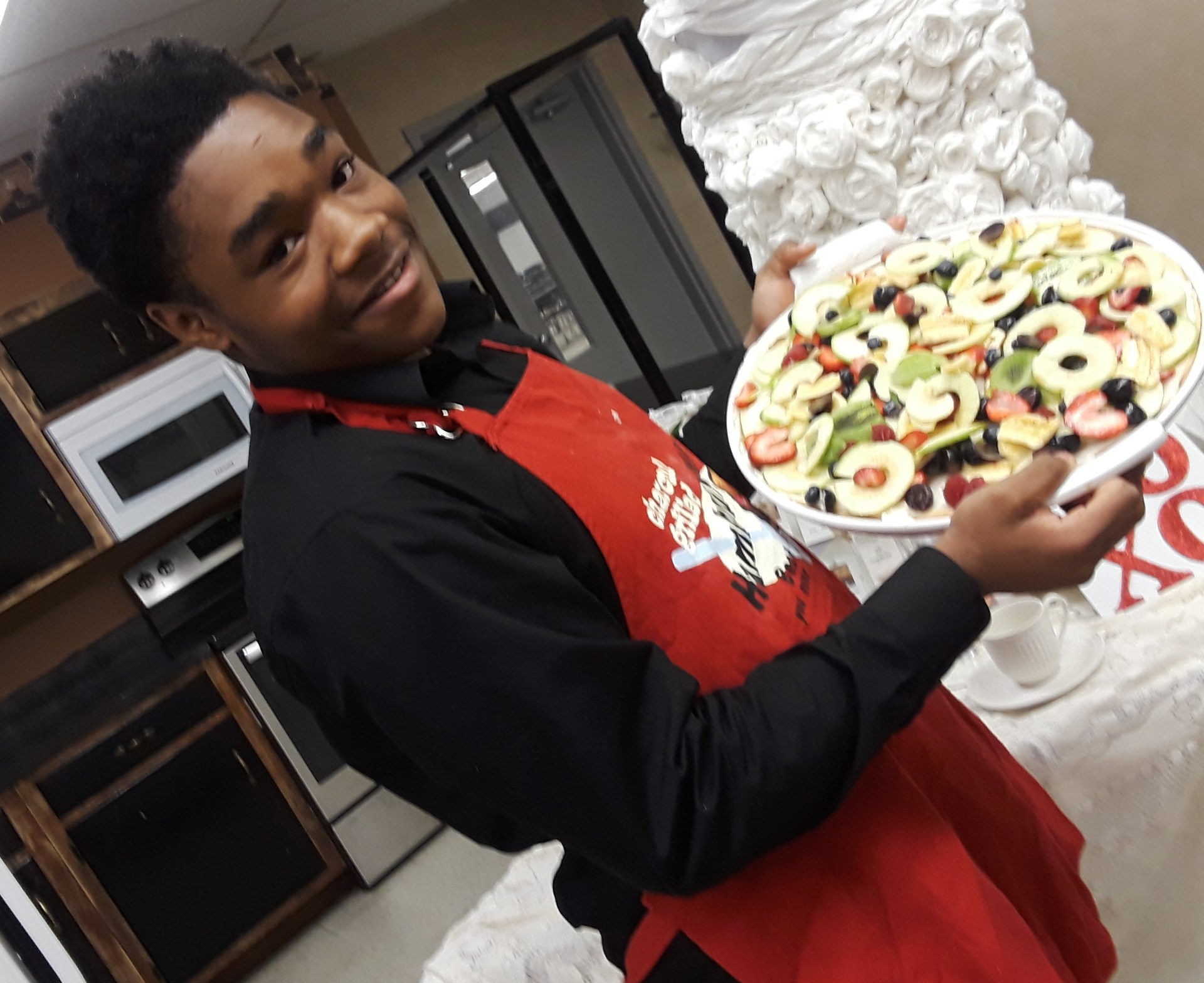 student with fruit pizza