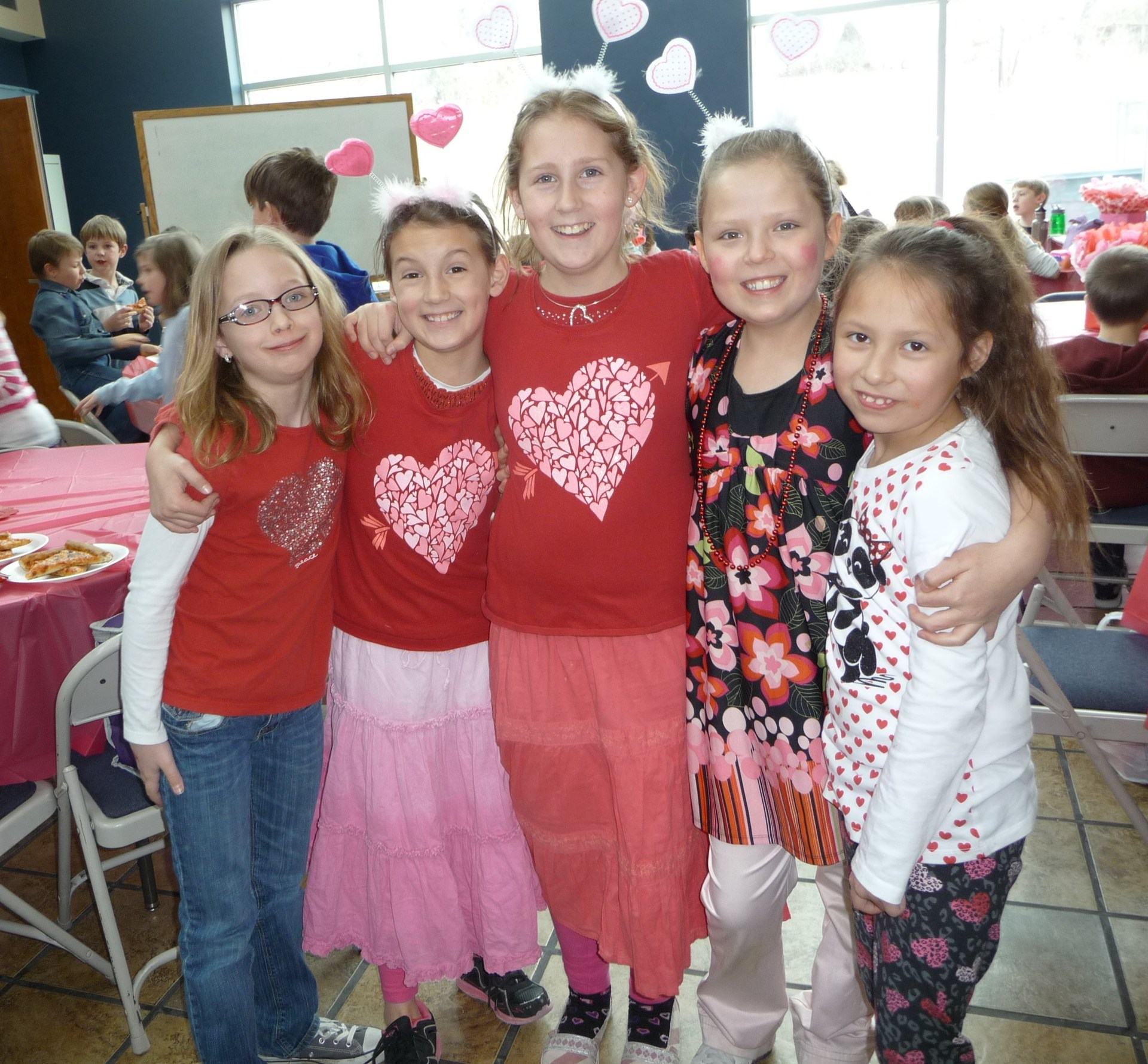 Students posing for a picture on Valentine's Day.