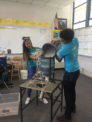 UCR volunteer helping Sara Oike during Science Olympiads.