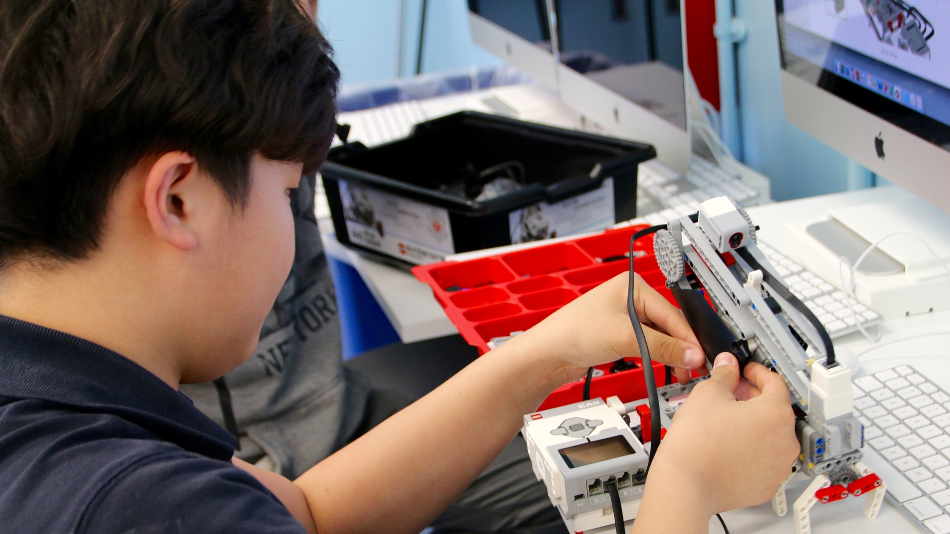 Boy building a robot