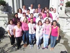 Roosevelt staff posing with their pink shirt supporting breast cancer awareness