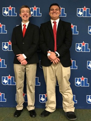 2 boys standing in front of UIL drop