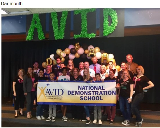 Photo of the Dartmouth AVID Staff Members holding their National Demonstration School banner