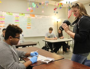 Hayley Harminson photographs a classmate during their pharmacy tech class