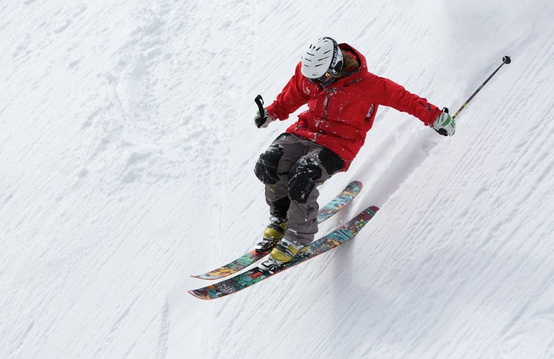Photo of a person downhill skiing.