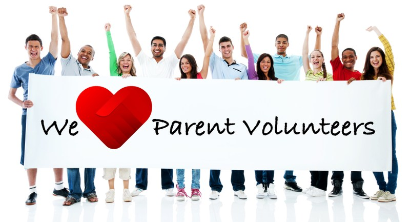 Photo of adults holding up a banner that reads we love parent voluteers