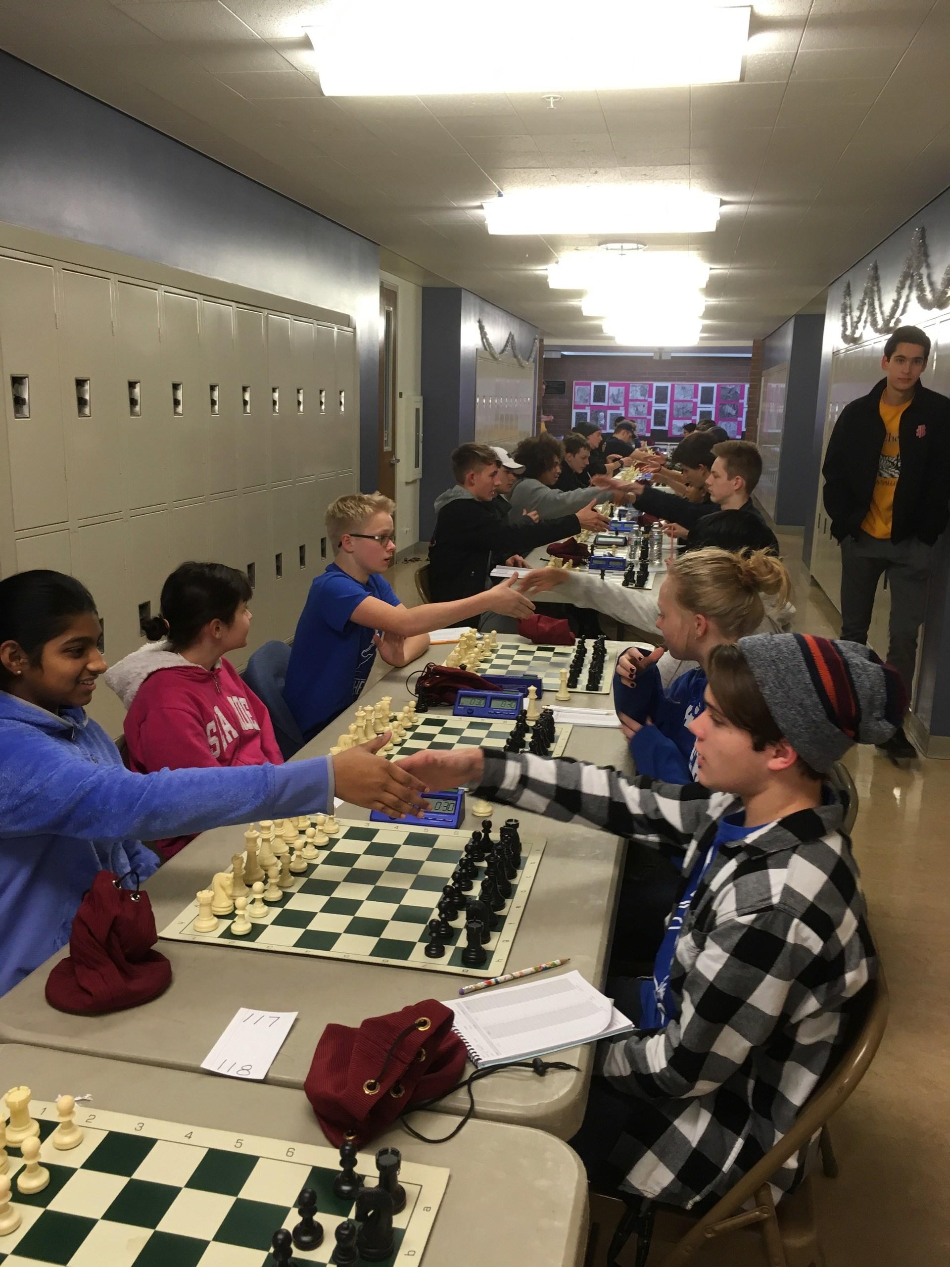 chess players shake before matches